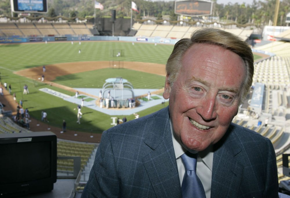 For 66 years, Dodgers announcer Vin Scully has provided the soundtrack for many of baseball's iconic moments. (AP/Mark J. Terrill)