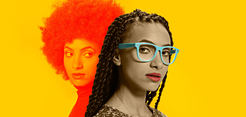 This recent promotional photo of Esperanza Spalding shows her new look -- long braids and pastel framed eyeglasses -- juxtaposed against the style of the Spalding that rose to fame in 2011. (Courtesy Shore Fire Media)