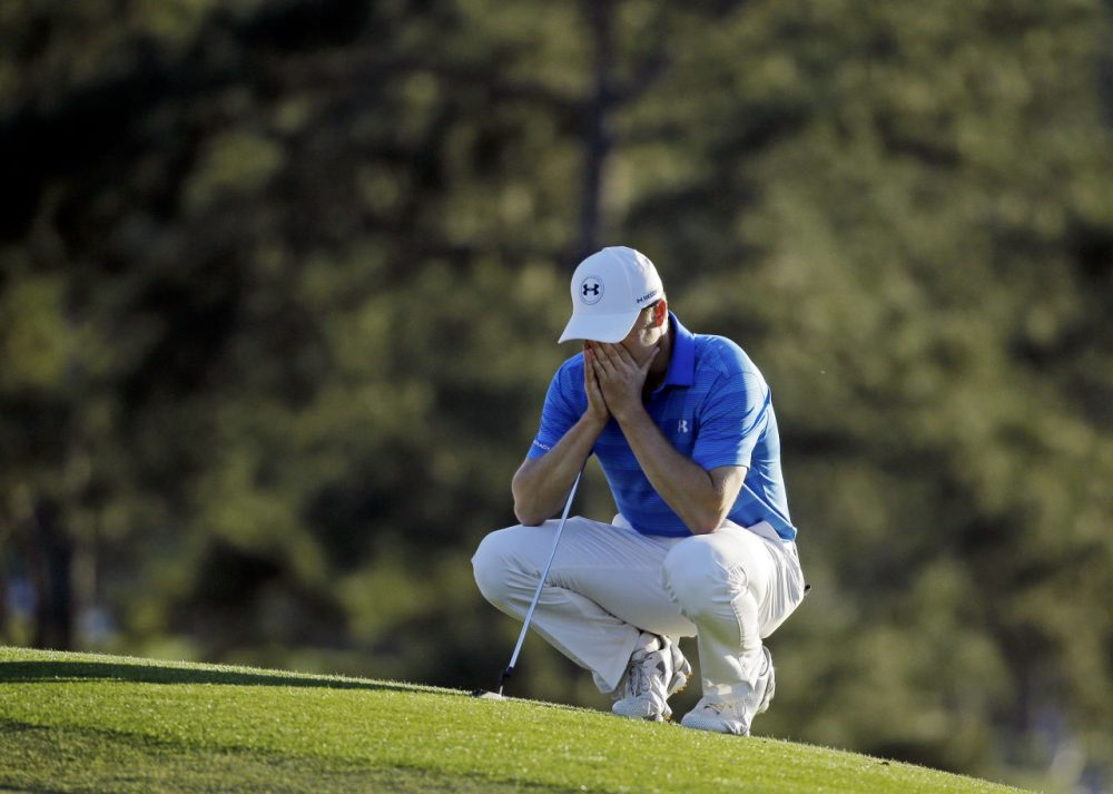 Jordan Spieth pauses on the 18th green before putting out during the final round of the Masters golf tournament Sunday, April 10, 2016, in Augusta, Ga. (Chris Carlson/AP Photo)