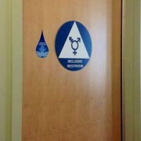 Taking the NBA and NCAA to task for their tepid response to the North Carolina law which limits the bathroom options for transgender people. Pictured: A gender neutral restroom at UC Irvine. (Serene Lau/flickr)