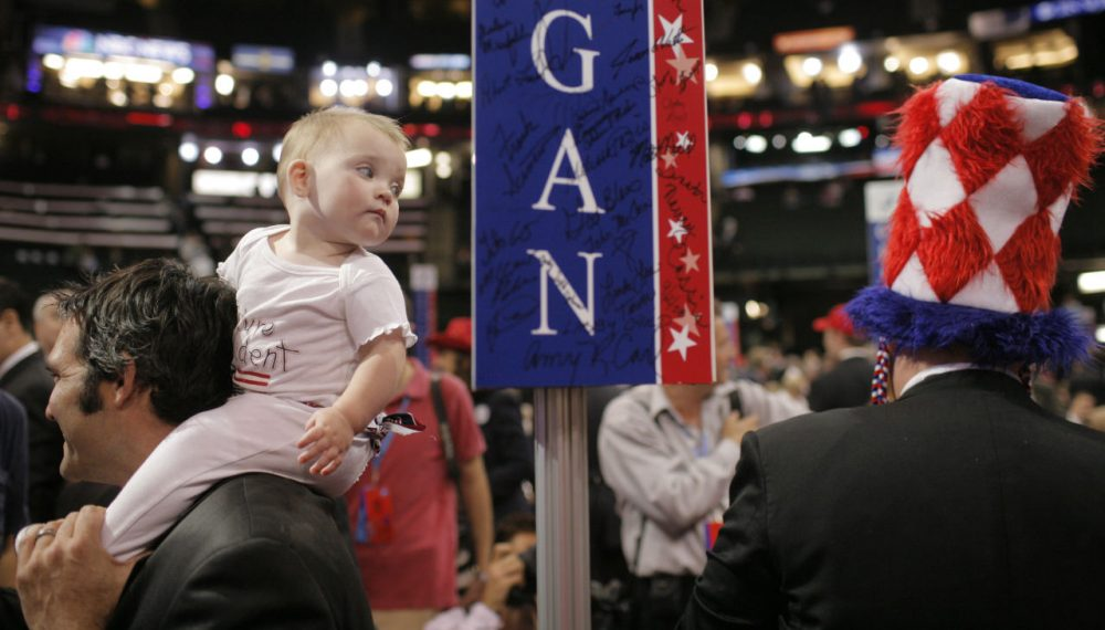 Nine-month-old Jetsen Minter looks at a passing delegate's hat as she sits on her father Derek Minter's shoulders at the Republican National Convention in St. Paul, Minn., Thursday, Sept. 4, 2008. Minter is a delegate from Holland, Michigan. (Jae C. Hong/AP)