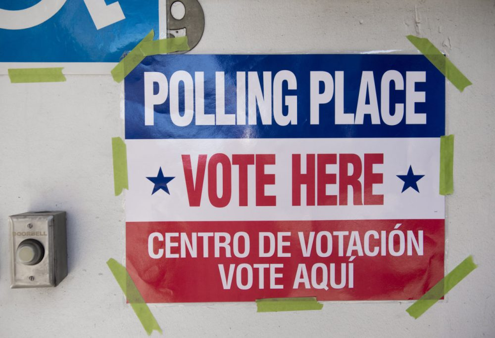 A sign for a polling place is seen during the Super Tuesday primary voting at a polling place located at Fire Station #10 in Arlington, Virginia, March 1, 2016. (Saul Loeb/AFP/Getty Images)