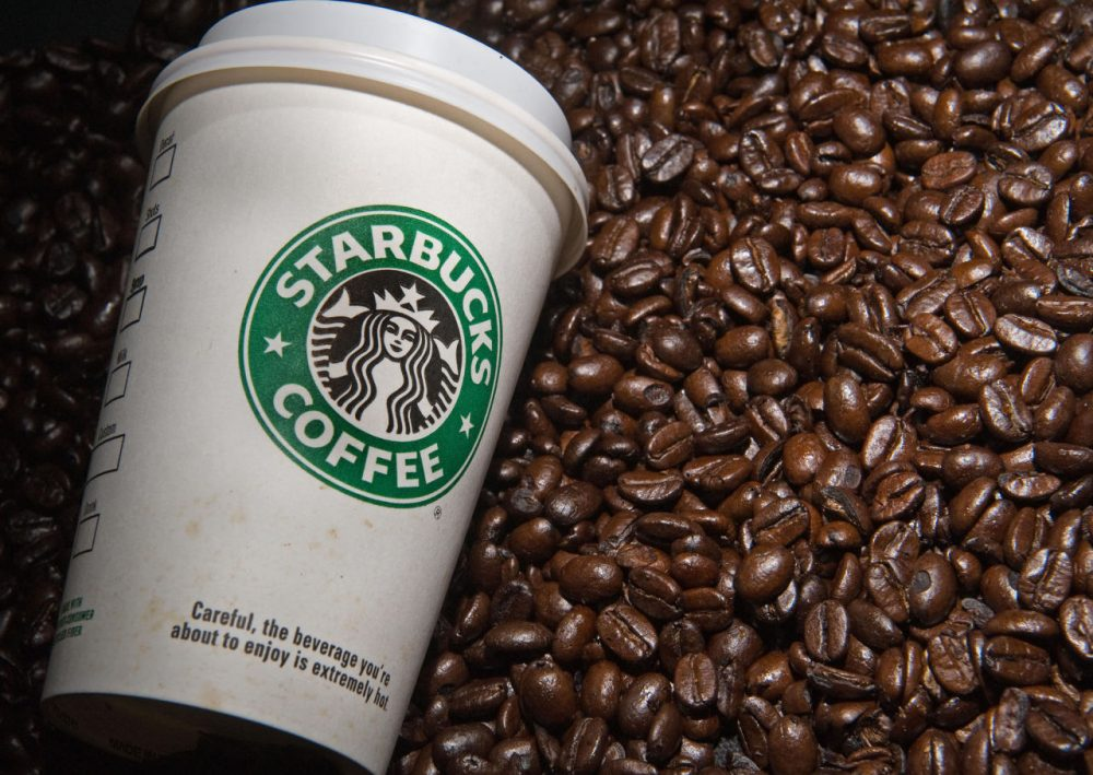A Starbucks coffee cup and beans are seen in this photo taken August 12, 2009 in Washington, DC.  (Paul J. Richards/AFP/Getty Images)
