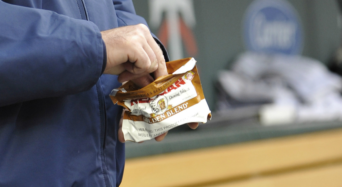 Chewing tobacco, seen here in this 2011 photo, has been a nearly two-century-old habit of many baseball players on the field and in the dugout. Boston's citywide ordinance banning all smokeless tobacco products from its sporting venues went into effect on April 1, 2016. (Jim Mone/AP)