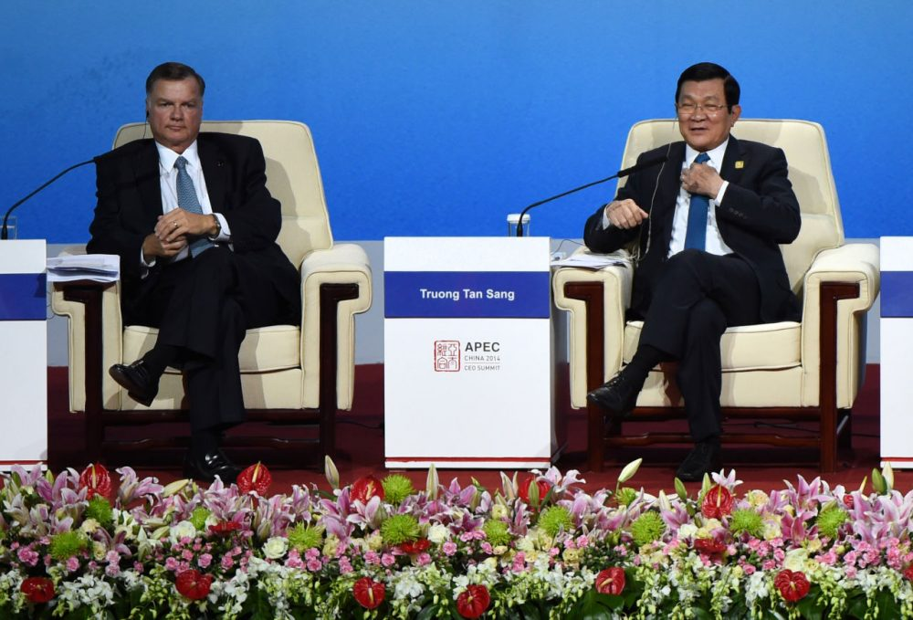 Vietnam's President Truong Tan Sang (R) speaks as Greg Boyce (L), chairman and CEO of Peabody Energy, looks on as they attend a dialogue at the APEC CEO Summit at the China National Convention Centre (CNCC) in Beijing on November 10, 2014, part of the Asia-Pacific Economic Cooperation (APEC) Summit.  APEC Economic Leaders' Meetings and APEC summit is being held at Beijing's outskirt Yanqi Lake.   (Wang Zhao/Getty Imgaes)