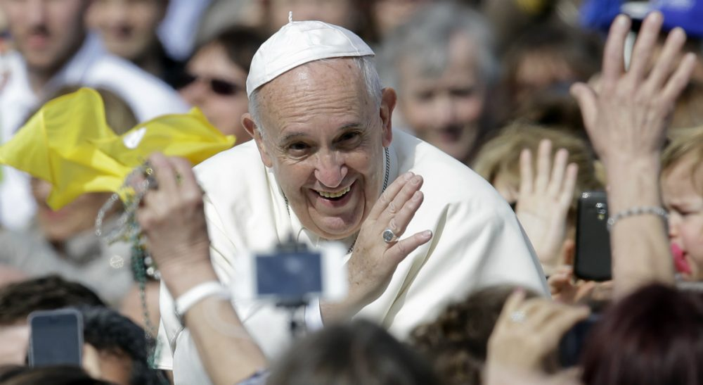 Pope Francis smiles as he blesses faithful as he arrives in St. Peter's Square to attend a jubilee audience at the Vatican, Saturday, April 9, 2016.  Francis has insisted that individual conscience be the guiding principle for Catholics negotiating the complexities of sex, marriage and family life in a major document released last week that repudiates the centrality of black and white rules for the faithful. In the 256-page document, Amoris Laetitia (The Joy of Love), the pope makes no change in church doctrine. (Gregorio Borgia/AP)