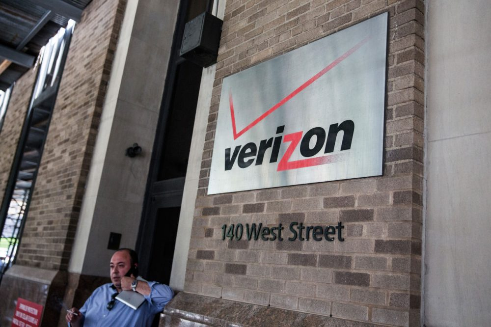 A sign hangs on the Verizon headquarters on May 12, 2015 in New York City. (Andrew Burton/Getty Images)