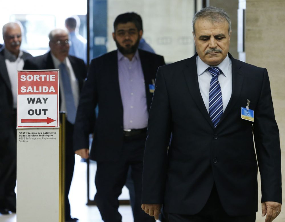 Members of the High Negotiations Committee (HNC) Mohamed Alloush of the Jaysh al Islam (C) and Asaad Al-Zoubi (R) arrive for a meeting with U.N. mediator as part of Syria Peace talks at the United Nations in Geneva, Switzerland, on April 13, 2016. (DENIS BALIBOUSE/AFP/Getty Images)