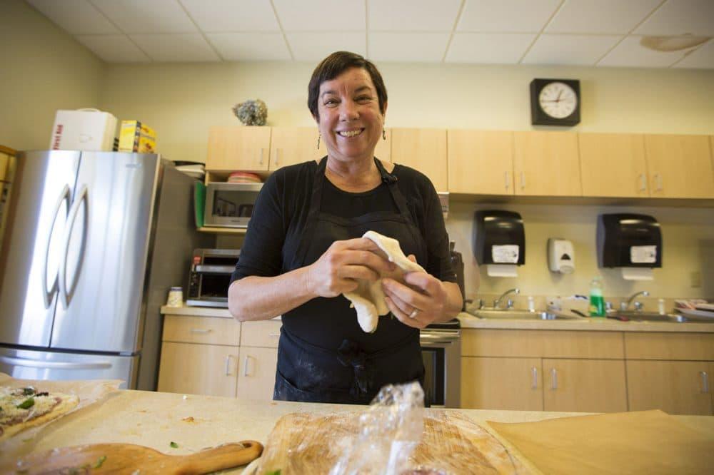 Kathy Gunst making pizza in the WBUR kitchen. (Jesse Costa/WBUR)