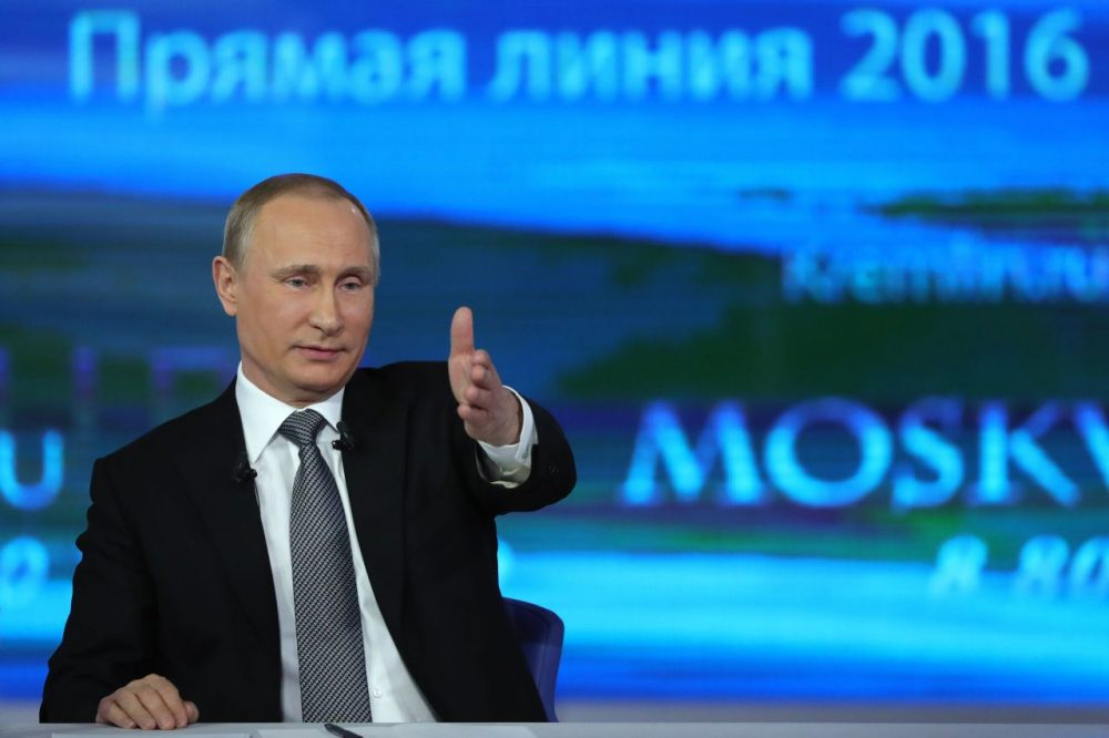 Russian President Vladimir Putin gestures while answering a question during his annual televised call-in show in central Moscow on April 14, 2016. (Mikhail Klimentyev/AFP/Getty Images)