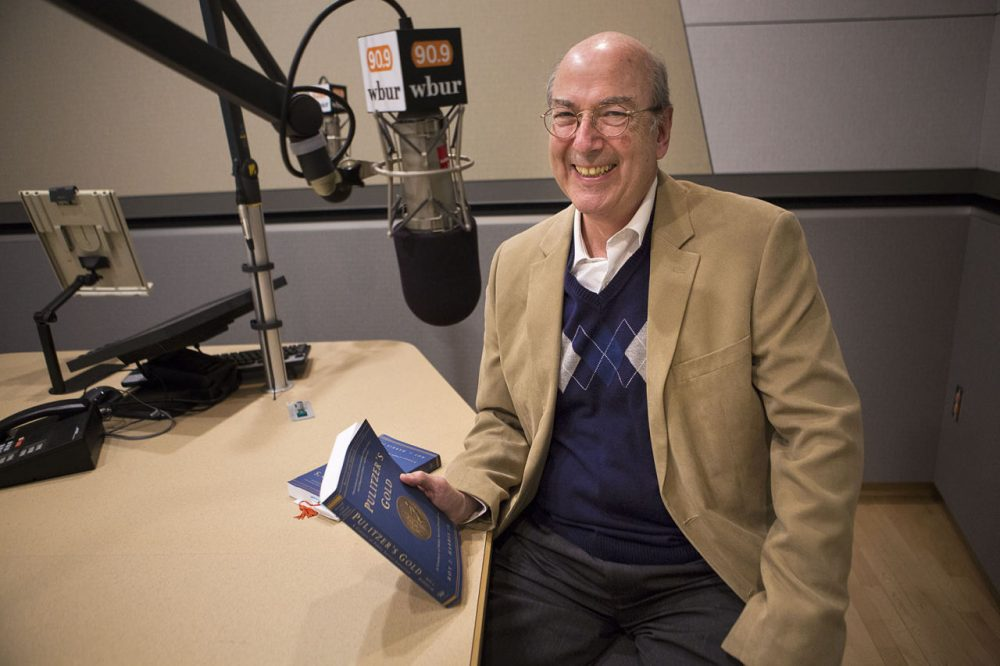 "Roy Harris Jr. with his book ""Pulitzer's Gold: A Century of Public Service Journalism"" in the WBUR studios. (Jesse Costa/WBUR)"