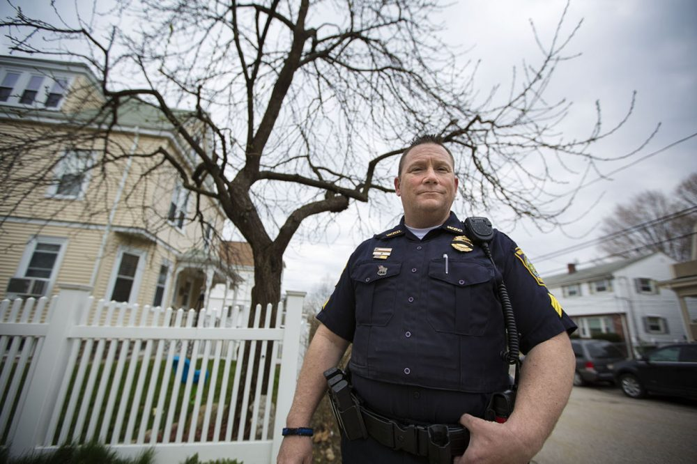 Watertown Police Officer John MacLellan stands in front of a tree on Laurel Street, which he and other police officers stood behind during the armed standoff with the Tsarnaevs in 2013. Four bullets were found in the trunk of the tree after the shootout. (Jesse Costa/WBUR)