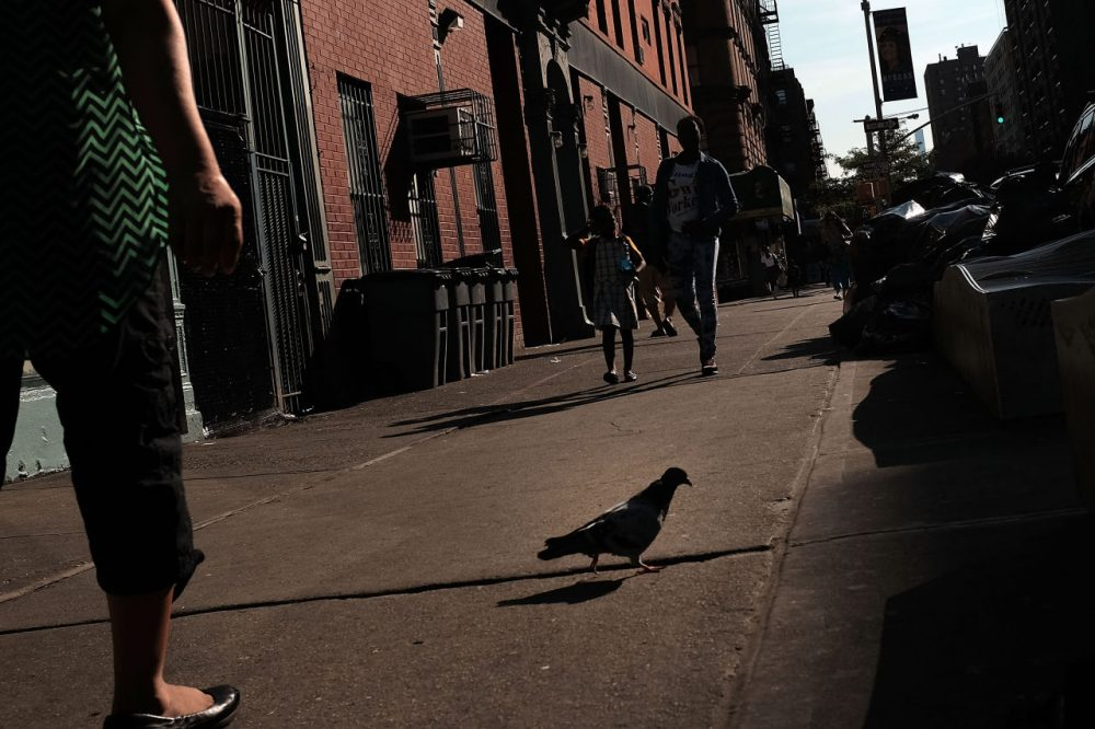 People walk in East Harlem on September 16, 2015 in New York City. (Spencer Platt/Getty Images)