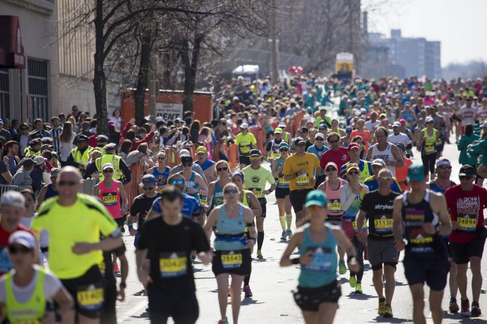 Hundreds of runners pour into Kenmore Square at mile 25 of the Boston Marathon. (Jesse Costa/WBUR)