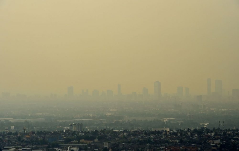 View from Tlanepantla of Mexico City blanketed by smog on March 18, 2016. Mexican officials lifted a four-day air pollution alert in the nation's densely-populated capital after ozone levels dropped, according to them, to acceptable levels. Mexico City authorities issued the first air pollution alert in 14 years due to high ozone levels, restricting traffic, encouraging children to stay indoors and ordering factories to cut emissions. (Ronaldo Schemidt/AFP/Getty Images)