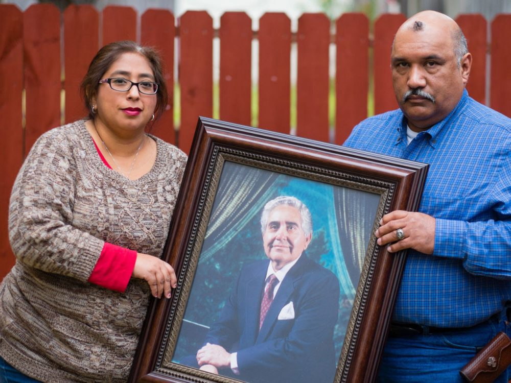Patty Rodriguez and her brother, Alex, hold a photo of their late father Demetrio Rodriguez on Sunday, March 1, 2015 in San Antonio. (Bahram Mark Sobhani)