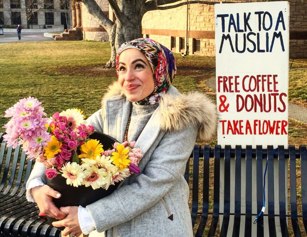 Mona Haydar hands out free coffee, donuts and flowers. (Courtesy Mona Haydar)