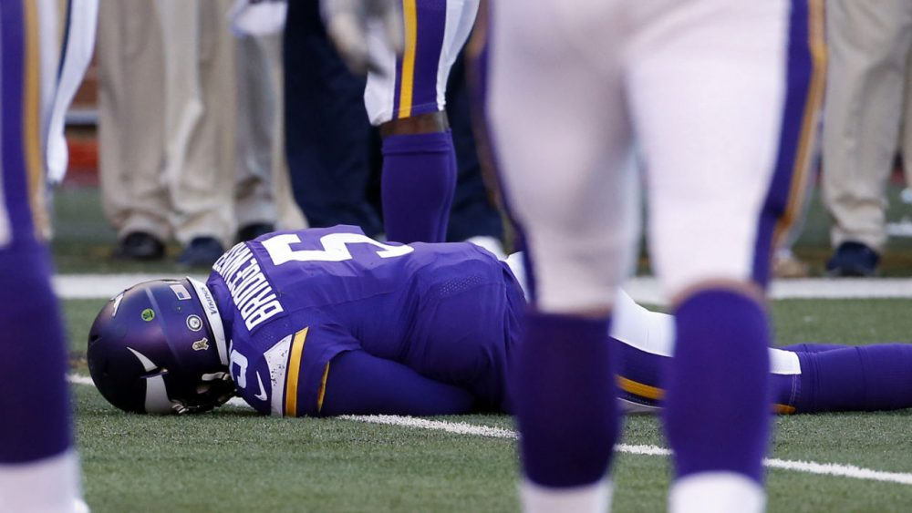 Minnesota Vikings quarterback Teddy Bridgewater lies on the field after suffering a concussion. On Monday, a three-judge panel  (AP Photo/Ann Heisenfelt, File)