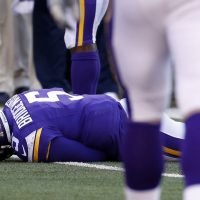 Minnesota Vikings quarterback Teddy Bridgewater lies on the field after suffering a concussion. On Monday, a three-judge panel  (AP Photo/Ann Heisenfelt, File)