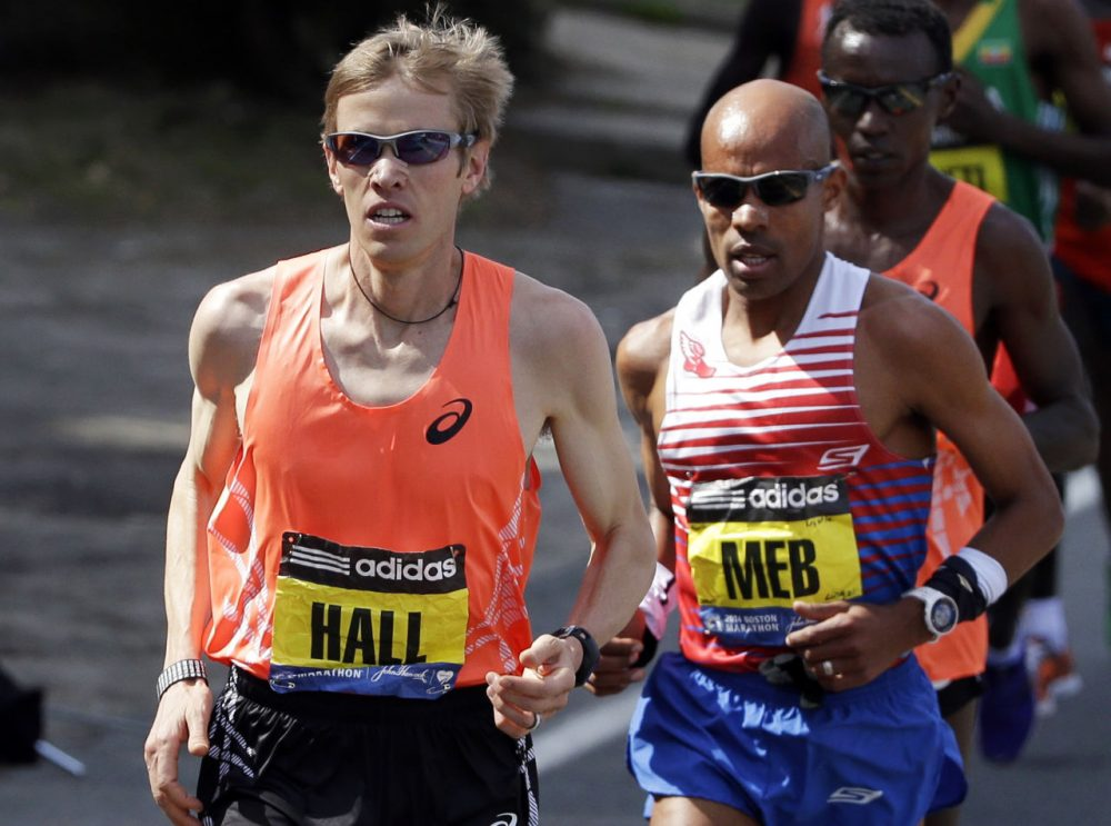 Ryan Hall, left, of Redding, California, runs near Meb Keflezighi, of San Diego, in the 2014 Boston Marathon. Keflezighi came in first place that year and it turned out to be Hall's final Boston appearance. (Steven Senne/AP)