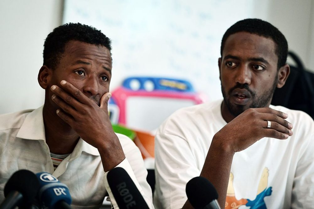 Survivors of a deadly shipwreck, Ismam Mowlid of Somalia (L) and Mahmud Muaz of Ethiopia react during a press conference in Athens on April 21, 2016. The UN refugee agency fears around 500 migrants from Africa had drowned in the Mediterranean, in what could be one of the worst tragedies since the start of the migrant crisis in Europe. The 41 survivors (37 men, three women and a three-year-old child) were rescued by a merchant ship and taken to Kalamata, in the Peloponnese peninsula of Greece on April 16. Those rescued include 23 Somalis, 11 Ethiopians, 6 Egyptians and a Sudanese. (LOUISA GOULIAMAKI/AFP/Getty Images)