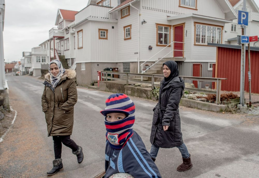 Refugees walk on the streets on February 10, 2016 in Kladesholmen, Sweden. Last year Sweden received 162,877 asylum applications, more than any European country proportionate to its population. According to the Swedish Migration Agency, Sweden housed more than 180,000 people in 2015, more than double the total in 2014. The country is struggling to house refugees in proper conditions during the harsh winter; summer holiday resorts, old schools and private buildings are being turned into temporary shelters for asylum seekers as they wait for a decision on their asylum application. Sweden is facing new challenges on its migration policy after the massive arrival of refugees last year, forcing the country to drastically reduce the number of refugees passing through its borders. Stricter controls have had a significant effect on the number of arrivals, reducing weekly numbers from 10,000 to 800. The Swedish migration minister announced in January that the government will reject up to 80,000 refugees who applied for asylum last year, proposing strict new residency rules.  (David Ramos/Getty Images)