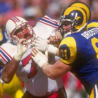 13 Sep 1992:  Defensive lineman Fred Smerlas of the New England Patriots (left) works against the Los Angeles Rams during a game at Anaheim Stadium in Anaheim, California.  The Rams won the game, 14-0. Mandatory Credit: Ken Levine  /Allsport