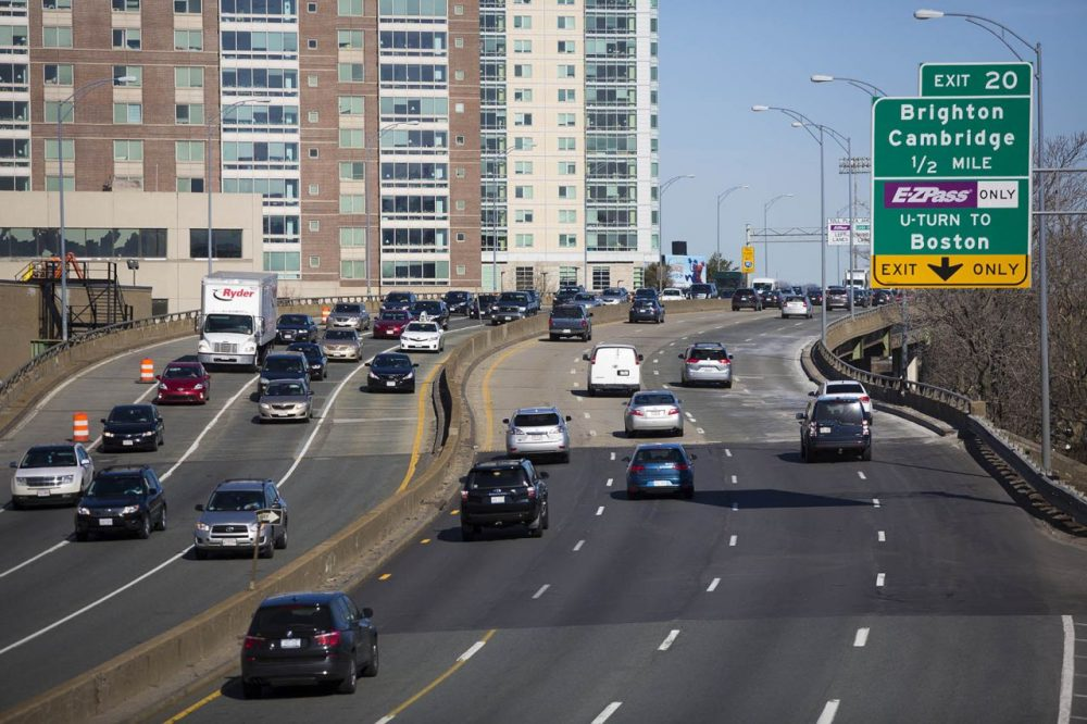 Morning traffic on the Mass. Pike, facing west, as it goes over Allston. A proposed project would change the highway's path through the neighborhood.  (Jesse Costa/WBUR)