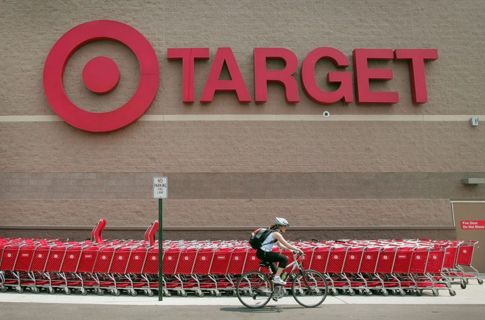 A bicyclist rides past a row of shopping carts outside a Target store on May 23, 2007 in Chicago, Illinois. (Photo by Scott Olson/Getty Images)