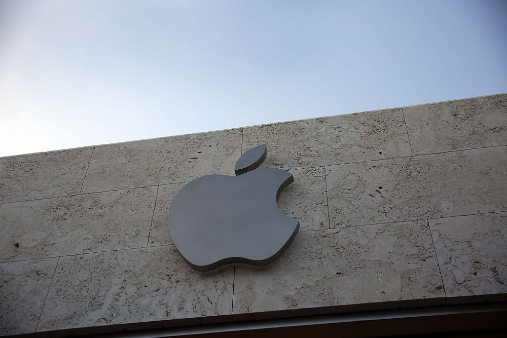 A sign is seen hanging outside of  an Apple computer store on April 26, 2016 in Miami Beach, Florida. Investors reacted negatively to the news that Apple Inc. reported adjusted quarterly earnings of $1.90 a share, below the $2 a share expected by analysts.  (Joe Raedle/Getty Images)