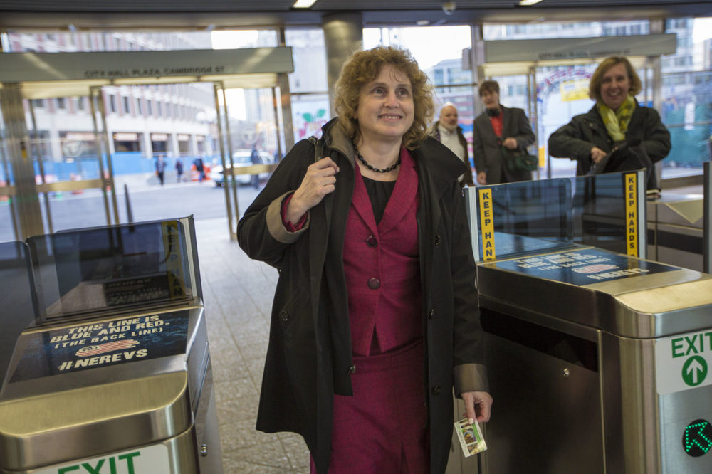 Secretary of Transportation Stephanie Pollack enters the turnstiles at the Government Center MBTA station on the Green Line during her commute to Newton. (Jesse Costa/WBUR)