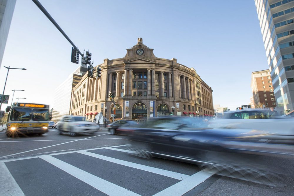 Traffic zooming by Boston's South Station. (Jesse Costa/WBUR)