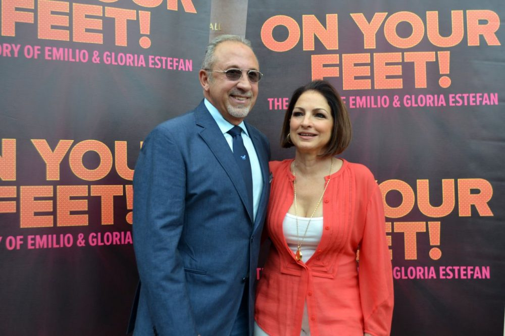 "In this Sept. 21, 2014 photo, Emilio Estefan, left, and Gloria Estefan pose for photos at the Adrienne Arsht Center for the Performing Arts in Miami during the casting for Broadway musical ""On Your Feet!"" (Ivan Cruz/AP)"