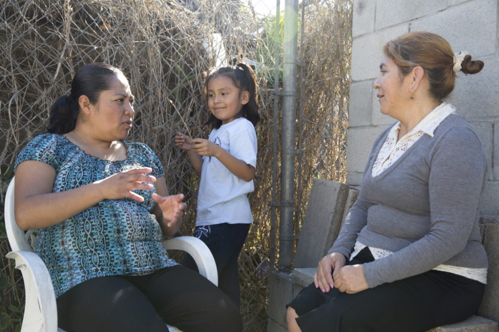 Rocio Alfaro (left), Wendy Mendez (middle) and Mery Alvarez (right) attend a lunch on Feb. 10, 2016 in Watts where the topic of conversation was the upcoming 2016 elections. (Dan Tufts for KPCC)