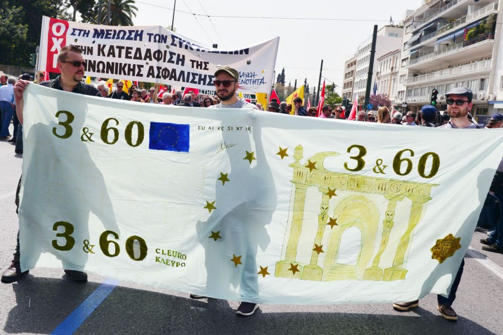 Protesters hold a banner depicting a mock Euro banknote during a protest in Athens marking the 24-hours civil servants' strike on April 7, 2016.  Greece's largest public sector union ADEDY called for the strike to protest against the government's planned pension reforms.  (Louisa Gouliamaki/AFP/Getty Images)
