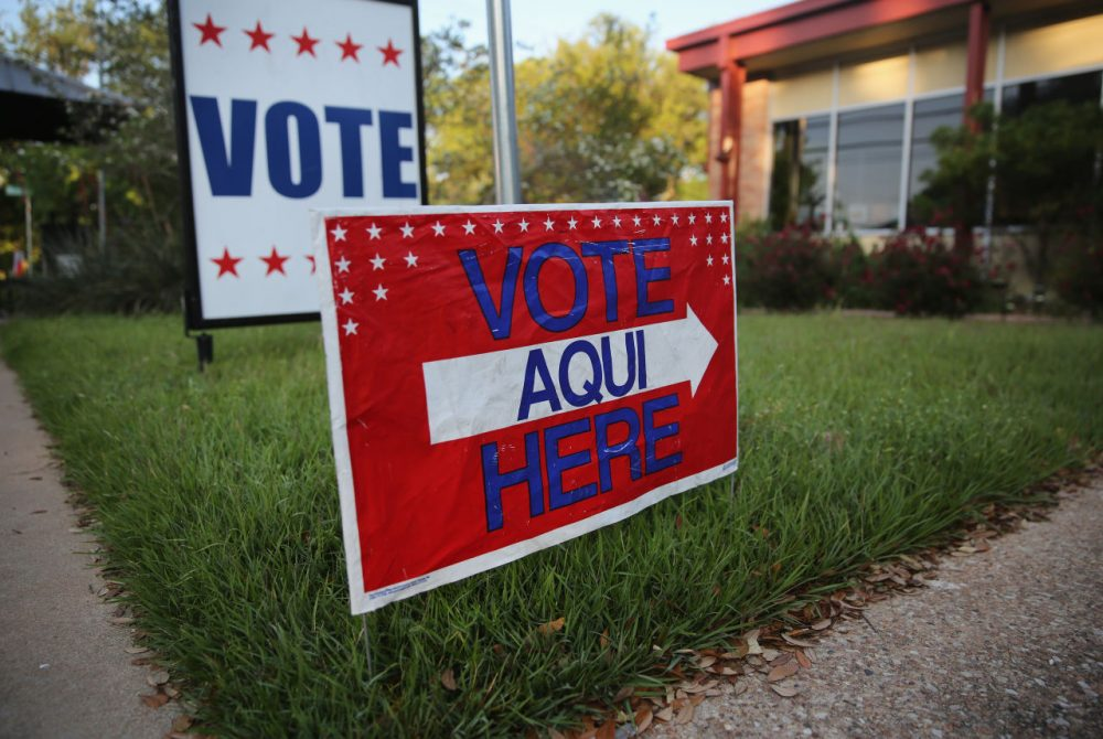 A bilingual sign stands outside a polling center at public library ahead of local elections on April 28, 2013 in Austin, Texas. Early voting was due to begin Monday ahead of May 11 statewide county elections.  (John Moore/Getty Images)