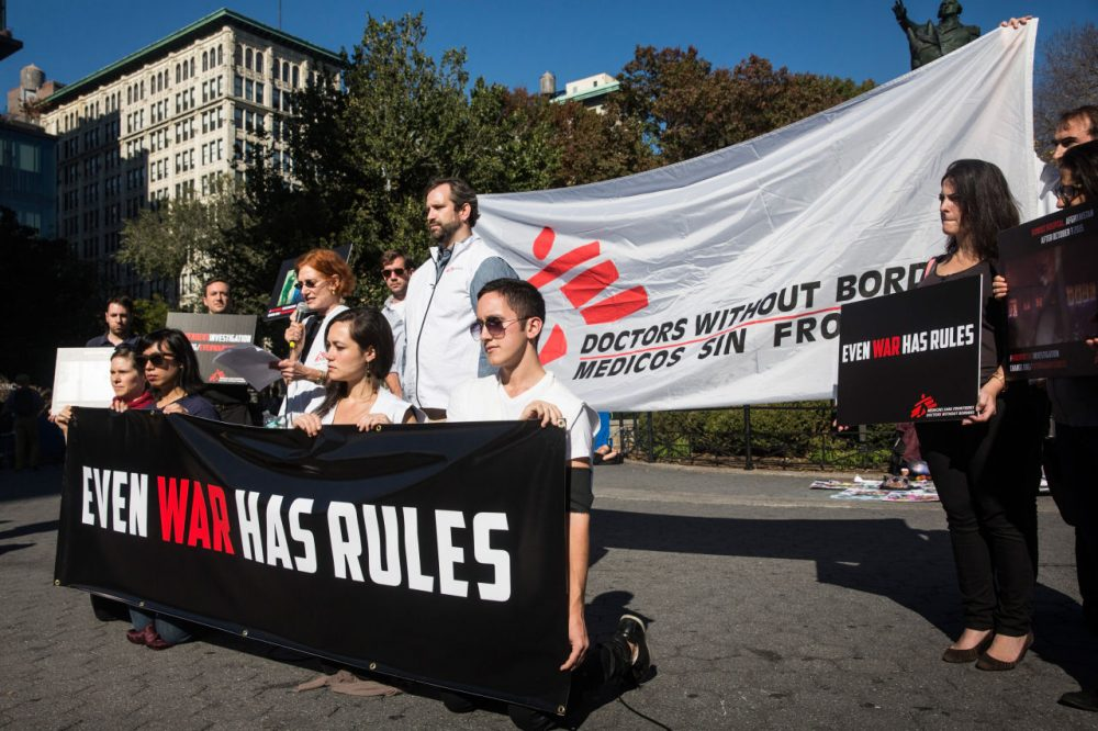 Supporters of Doctors Without Borders/Medecins Sans Frontieres (MSF) gather in Union Square to commemorate the one month anniversary of the bombing of a MSF hospital in Kunduz, Afghanistan on November 3, 2015 in New York City. (Andrew Burton/Getty Images)