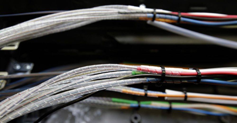 Verizon is now bringing the high speed Internet and cable television competition it already offers in other parts of Massachusetts to Boston. Pictured: Glass fibers, housed inside narrow cables, are seen as they're being connected to the Verizon Fios fiber network in Rockville, Maryland. (Alex Brandon/AP)