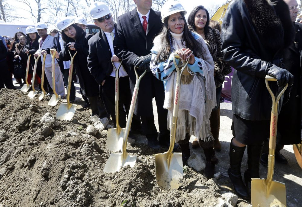 Tribal Council member Winnie Johnson Graham holds a shovel along with others during Tuesday's groundbreaking of the Mashpee Wampanoag tribe's casino. (Elise Amendola/AP)