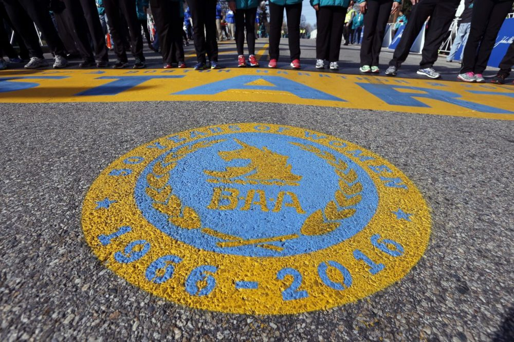The 2016 start line for the Boston Marathon features a seal honoring 50 years of women running (Michael Dwyer/AP)