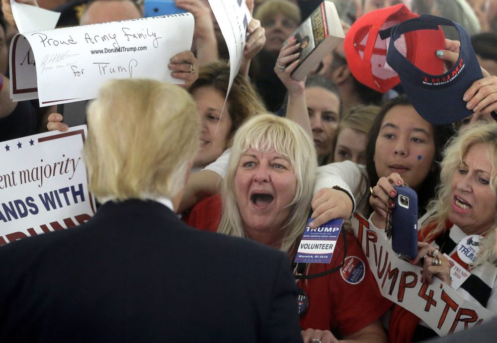 Republican presidential candidate Donald Trump greets people in the crowd after speaking at a campaign rally Monday in Warwick, R.I. (Steven Senne/AP)