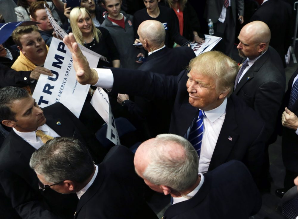 Republican presidential candidate Donald Trump greets supporters after a rally in Albany, New York, on Monday. (Mike Groll/AP)