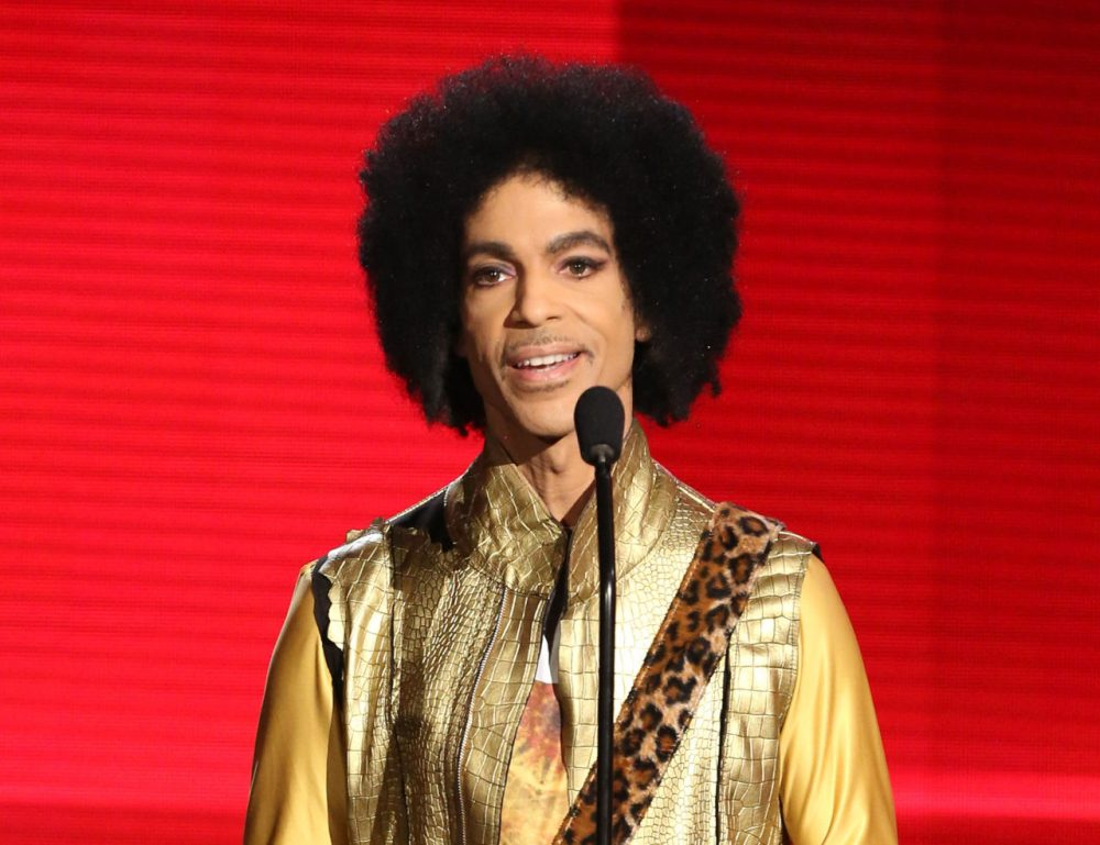 "FILE - In this Nov. 22, 2015 file photo, Prince presents the award for favorite album - soul/R&B at the American Music Awards in Los Angeles. Prince, widely acclaimed as one of the most inventive and influential musicians of his era with hits including ""Little Red Corvette,"" ''Let's Go Crazy"" and ""When Doves Cry,"" was found dead at his home on Thursday, April 21, 2016, in suburban Minneapolis, according to his publicist. He was 57. (Photo by Matt Sayles/Invision/AP, File)"