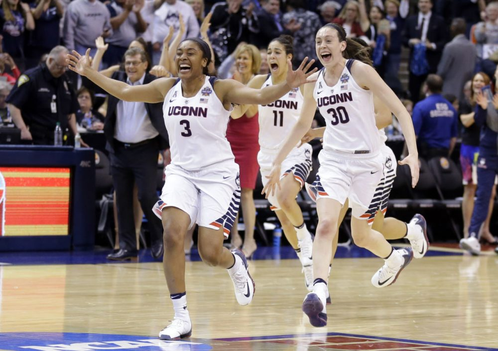 The UConn women's basketball team topped Syracuse to win their fourth consecutive national championship Tuesday night. (Michael Conroy/AP)