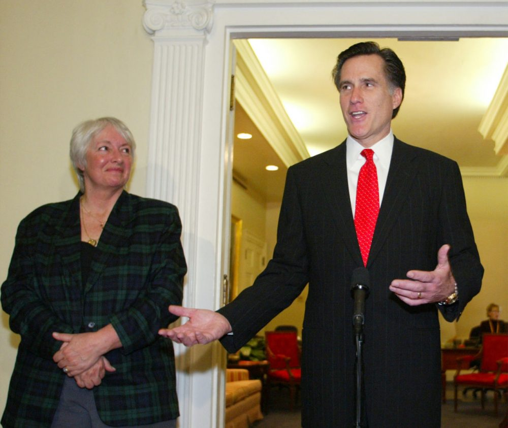 Massachusetts Gov. Mitt Romney and Barbar Anderson of Citizens for Limited Taxation, at the State House in 2004, talk about proposed state legislation to provide tax breaks for senior citizens. (Bizuayehu Tesfaye/AP)