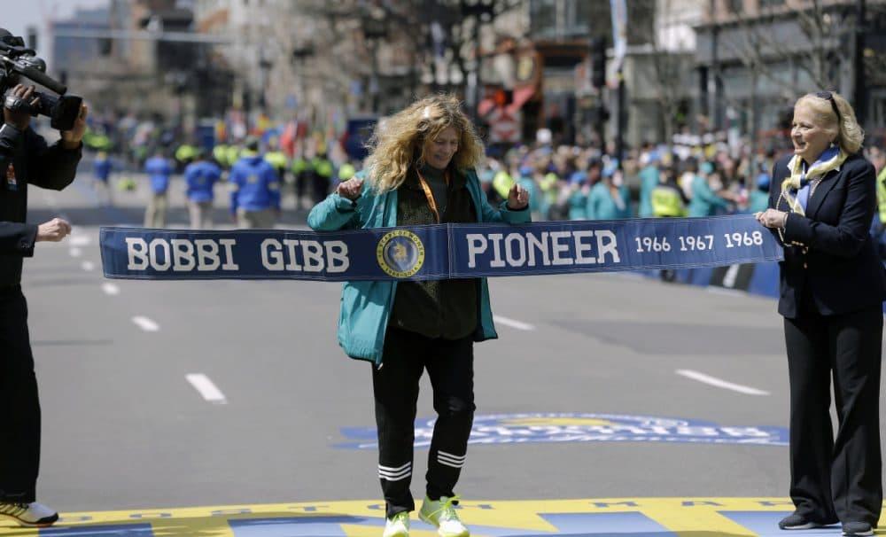 Bobbi Gibb, first woman to run the Boston Marathon in 1966, crosses at the finish line of the 120th Boston Marathon on Monday. (Elise Amendola/AP)