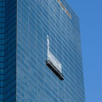 """Anita Diamant: """"Now I see the former Hancock Tower as a stunning canvas, shimmering blue or grey in answer to the seasonal sky, waiting for a new image to materialize."""" (Jesse Costa/WBUR)"""
