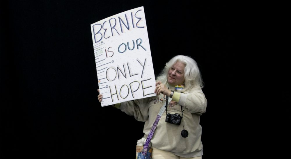 An exhortation, in verse, to Bernie-or-Bust supporters in New York and beyond to embrace pragmatism -- and Hillary Clinton -- come November. Pictured: Patrice Fowler, right, of Edinboro, Pa., holds a sign while waiting for Democratic presidential candidate, Sen. Bernie Sanders, I-Vt., to arrive during a campaign rally in Erie, Pa., Tuesday, April 19, 2016. (Mary Altaffer/AP)