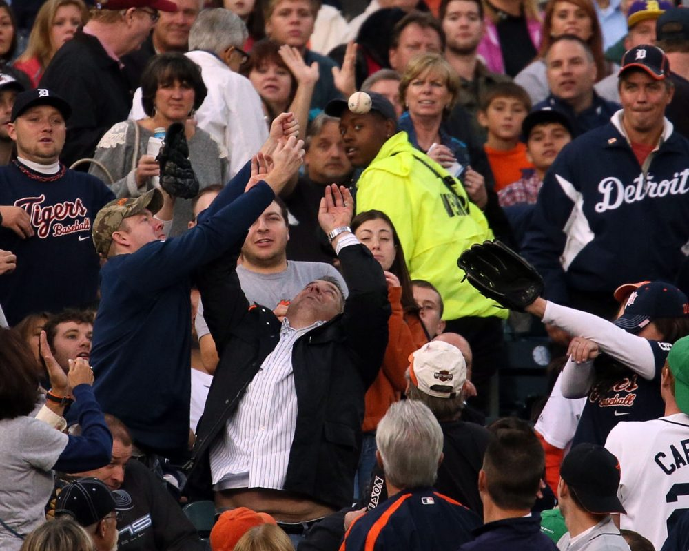 Some baseball fans consider themselves lucky if they snag one foul ball. Bil Dugan caught five -- in one game.  (Dave Reginek/Getty Images)