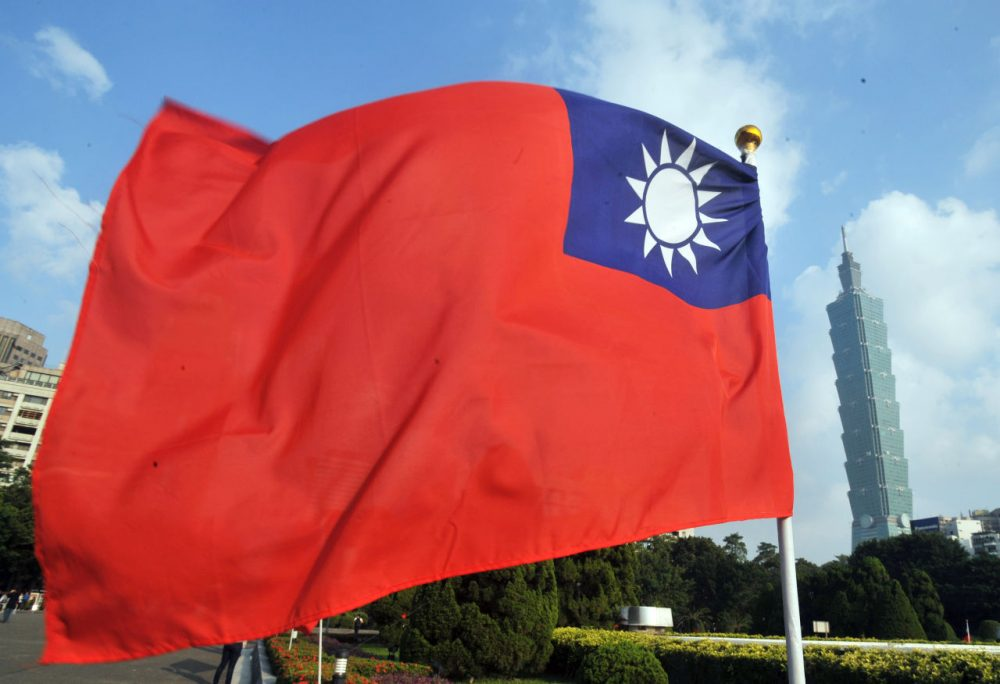 Taiwan's national flag flutters beside Taipei 101 at Sun Yat-sen Memorial Hall in Taipei on October 7, 2012. (Mandy Cheng/AFP/GettyImages)